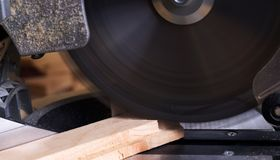 Carpenter tools on wooden table with sawdust. Circular Saw. Cutting a wooden plank Royalty Free Stock Image