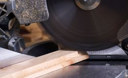 Carpenter tools on wooden table with sawdust. Circular Saw. Cutting a wooden plank.  royalty free stock photography
