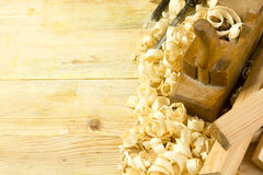 Carpenter tools on wooden table with sawdust. Craftperson workplace top view Stock Photography