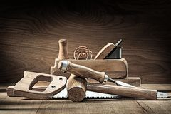 Carpenter Tools Woodworkers Plane Wooden Mallet Chisel Handsaw On Vintage Wooden Background Stock Photography