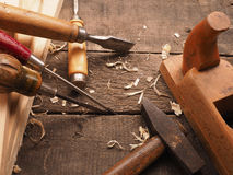 Carpenter tools on a workbench Royalty Free Stock Image