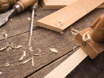 Carpenter tools on a workbench. Old used carpenter tools on a wooden workbench Stock Images