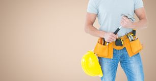 Carpenter torso with hammer against cream background Stock Photo