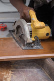 Carpenter use electric saw to sawing wood Stock Photo
