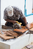 Carpenter use electric saw to sawing wood Royalty Free Stock Image