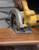 Carpenter use electric saw to sawing wood Stock Image