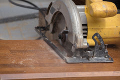 Carpenter use electric saw to sawing wood Royalty Free Stock Photography