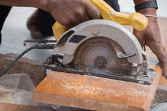 Carpenter use electric saw to sawing wood Royalty Free Stock Images