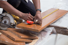Carpenter use Measure tape to measuring wood Stock Photos
