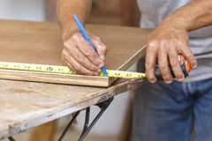 Carpenter use saw cut wood for make new furniture Stock Photography