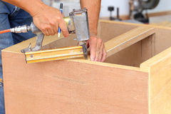Carpenter used air-gun for make new furniture Royalty Free Stock Photos