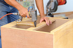 Carpenter used air-gun for make new furniture Royalty Free Stock Photography