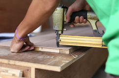 Carpenter used a nail gun Royalty Free Stock Image