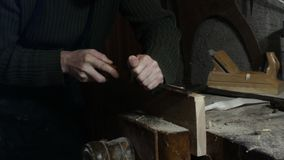 Carpenter uses a carpenter`s chisel royalty free stock photo