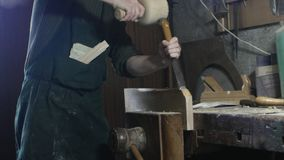 Carpenter uses a carpenter`s chisel stock photo