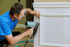 Free Carpenter Using A Brad Nail Gun To Complete Framing Trim Stock Photos - 96785103