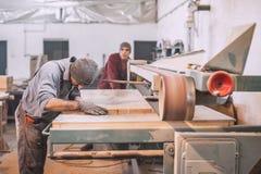 Carpenter using belt sander Stock Photo