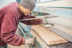 Carpenter using belt sander Royalty Free Stock Images