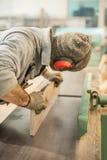 Carpenter using belt sander Stock Photography