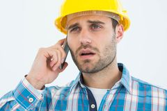 Carpenter using cellphone Royalty Free Stock Image