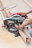 Carpenter using circular saw for wood Stock Image