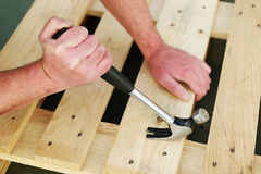 Carpenter using a claw hammer Stock Photos