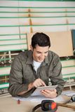 Carpenter Using Digital Tablet At Table Royalty Free Stock Photography