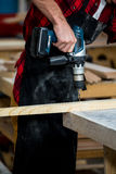 Carpenter using a drill Royalty Free Stock Photo