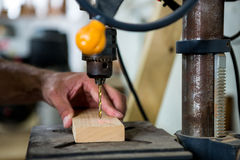 Carpenter using a drill Stock Image