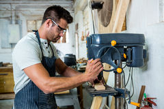 Carpenter using a drill Royalty Free Stock Image