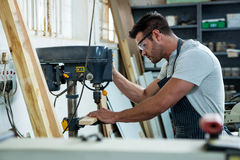 Carpenter using a drill Stock Photography