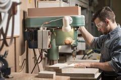Carpenter using drill machine Royalty Free Stock Photos