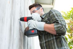 Carpenter using drill machine Stock Photography