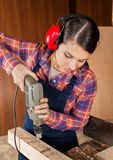 Carpenter Using Drilling Machine On Wood Royalty Free Stock Images