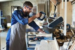 Carpenter Using Electric Cutting Unit royalty free stock photography