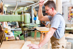 Carpenter using electric drill in carpentry Stock Photos