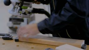 Carpenter using electric sander to polish wood. Professional man carpenter using electric sander to polish wood on rough workbench at workshop. Design, carpentry stock video