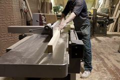 Carpenter using electric saw. Carpentry. Carpenter working in his workshop Stock Photo