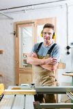 Carpenter using electric saw in carpentry Stock Photos