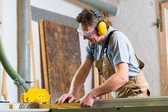 Carpenter using electric saw in carpentry Royalty Free Stock Images