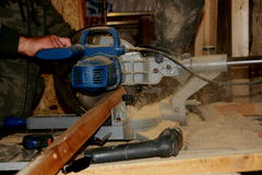 Carpenter using electric saw Stock Images