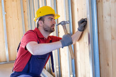 Carpenter Using Hammer Stock Photo