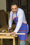 Carpenter using a hammer Stock Images