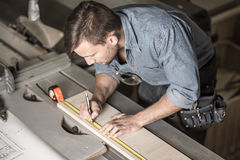 Carpenter using a measuring tape royalty free stock photography