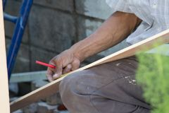 A carpenter is repairing the house. royalty free stock photo