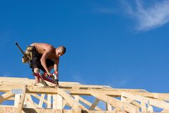 Carpenter Using Nail Gun Royalty Free Stock Photography