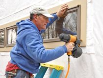 Carpenter using nail gun Royalty Free Stock Images
