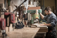 Carpenter using new technology Royalty Free Stock Images