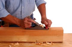 Carpenter using plane Stock Images
