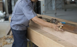 Carpenter using plane tool. Stock Images